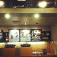 Photo taken at Starbucks Coffee by Emerson N. on 7/19/2012