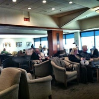 Photo taken at Delta Sky Club by Rebecca M. on 2/12/2012