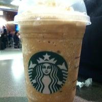 Photo taken at Starbucks by Jennifer R. on 3/18/2012
