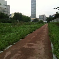 Photo taken at 안양천 산책로 by Eun Shil S. on 8/22/2012