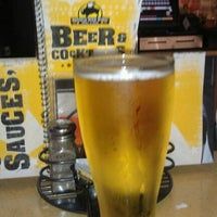 Photo taken at Buffalo Wild Wings by Rusty V. on 4/14/2012