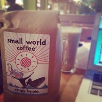 Photo taken at Small World Coffee by Andrew C. on 6/14/2012