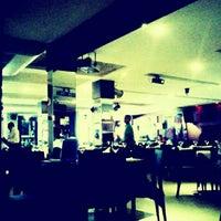 Photo taken at Manhattan Café Theatro by Arthur M. on 11/14/2011