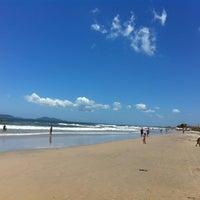 Photo taken at Praia de Itapoá by Daniel D. on 1/3/2012