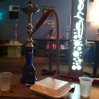 Photo taken at She-Sha Café & Hookah Lounge by Sarah J. on 4/24/2011