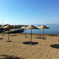 Photo taken at Küçükkuyu Plajı by TC Ayça ERTÜRK . on 8/17/2012