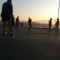 Photo taken at Bostanlı Basketbol Sahası by Mert A. on 10/30/2011