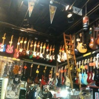 Photo taken at Rockin' Robin Guitars & Music by Becky L. on 1/8/2012