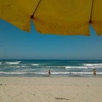 Photo taken at Praia Itamambuca by Camila P. on 8/25/2012