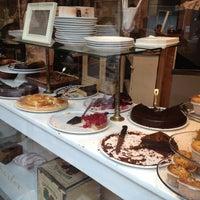 Photo taken at Flower's Café by Emma O. on 9/4/2012