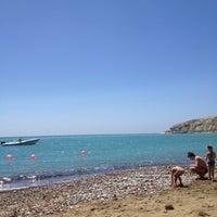 Photo taken at Pissouri Beach by Nstya N. on 4/22/2012