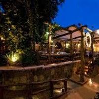 Photo taken at Restaurant La Rueda 1975 by Izys M. on 9/9/2012