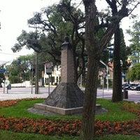 Photo taken at Praça Miguel Couto (Pracinha do Batel) by Felipe R. on 2/25/2012