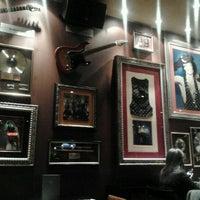 Photo taken at Hard Rock Cafe Lisbon by Joana M. on 2/1/2012