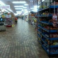 Photo taken at Woodman's Food Market by Tia C. on 8/26/2011