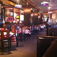 Photo taken at TGI Fridays by Christopher L. on 11/10/2011