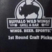Photo taken at Buffalo Wild Wings by Elvis M. on 6/23/2012