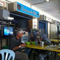 Photo taken at Asam Pedas Commando Kiosk by Teka T. on 3/27/2012