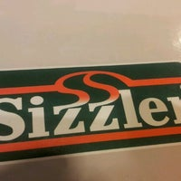 Photo taken at Sizzler by Dilip G. on 11/30/2011