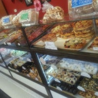 Photo taken at D'Amato's Bakery by Brandon G. on 2/21/2012