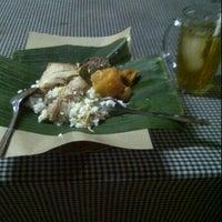 Photo taken at Mbah MANGUN Lesehan Gudeg Jogja by Joe Z. on 2/14/2012