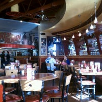 Photo taken at Red Robin Gourmet Burgers by Dion H. on 1/1/2012