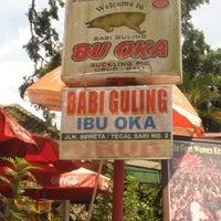 Photo taken at Babi Guling Ibu Oka by Karoline C. on 6/18/2012