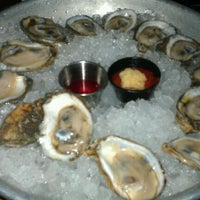 Photo taken at Pearlz Oyster Bar by Taylor K. on 1/7/2012
