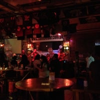Photo taken at Handlebar Bar and Grill by Atticus K. on 12/22/2011