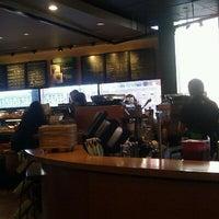 Photo taken at Starbucks by Liza S. on 3/7/2012