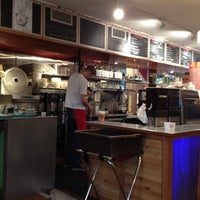 Photo taken at Small World Coffee by Manny L. on 3/11/2012