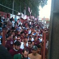 Photo taken at Estádio Conde Rodolfo Crespi by Caio P. on 4/14/2012