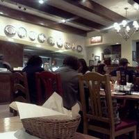Photo taken at Carino's Italian Restaurant by Gabriella H. on 11/6/2011