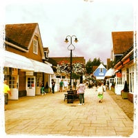 Photo taken at Bicester Village by Andrea S. on 8/22/2012