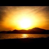 Photo taken at Belcekız Plajı by Deniz U. on 5/22/2012
