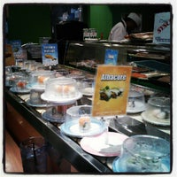 Photo taken at Kura Sushi by Monet Q. on 7/24/2012