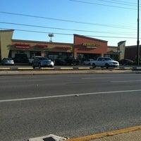 Photo taken at Bedrock City Comic Co. by Ruben L. on 4/24/2012
