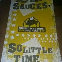 Photo taken at Buffalo Wild Wings by Nikeshi M. on 5/5/2012