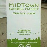 Photo taken at Midtown Farmer's Market by Adam K. on 5/5/2012