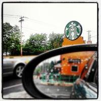 Photo taken at Starbucks by Jude B. on 7/15/2012