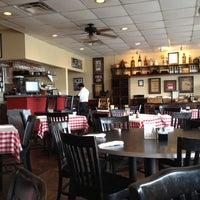 Photo taken at Corelli's Italian Cafe by Nik R. on 5/1/2012
