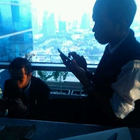 Photo taken at 8 PUB & LOUNGE (Sky Lounge 33rd Floor) by Vivi A. on 11/24/2011