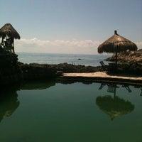 Photo taken at Playa Xcaret by Cinthii on 8/2/2012