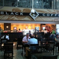 Photo taken at Black Coffee by Fabio D. on 12/27/2011