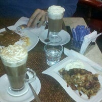 Photo taken at Suca Chocolate Lounge & Coffee by Walter P. on 6/12/2011
