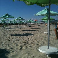 Photo taken at Плаж Аспарухово (Asparuhovo beach) by Ralitsa P. on 9/10/2011
