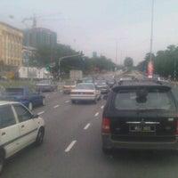Photo taken at Traffic Light Gate UiTM Seksyen 7 by Awal S. on 2/20/2012