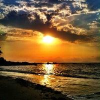 Photo taken at Praia de Samil by Katia K. on 3/1/2012