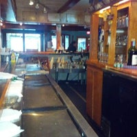 Photo taken at Bummz Beach Cafe by Mitch C. on 7/10/2012