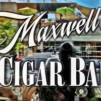 Photo taken at Maxwell's Cigar and Wine Bar by Ben T. on 8/11/2012
